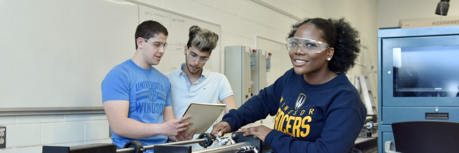 Three students working in an engineering lab
