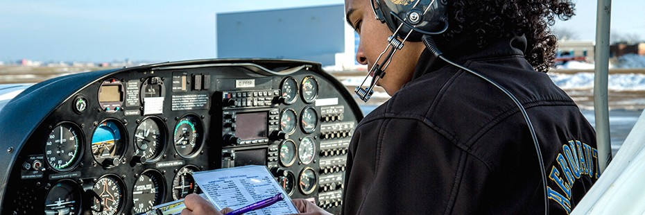 Student completes preflight check in plane's cockpit