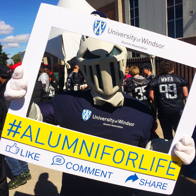 UWin Mascot Winston with Alumni for life frame