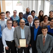 Engineering professor Mohammed Khalid, pictured centre with members of the IEEE Windsor Section, displays an award the group received under his leadership. Khalid has been elected to the executive committee of the Institute of Electrical and Electronics Engineers (IEEE) Canada.