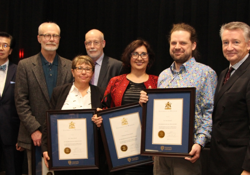 University officials congratulate winners of the UWindsor Award for Excellence in Scholarship, Research, and Creative Activity in the category of Established Scholars and Researchers: (from left) VP research and innovation K.W. Michael Siu, English professor Tom Dilworth, sociology professor Tanya Basok, acting provost Jeff Berryman, law professor Reem Bahdi, biology professor Dan Mennill, and interim president Douglas Kneale.
