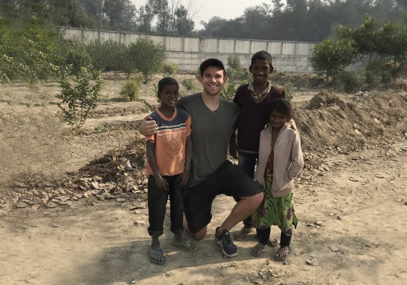 UWindsor student Dylan Verburg was often greeted by youngsters Kishan, Guddu, and Maya during his trips to a lake outside the Indian capital city of New Delhi, where he was conducting his master's research on water quality.