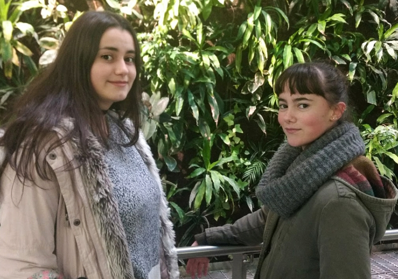 Iria Campos of Riverside Secondary School and Tania Rodríguez of Holy Names Catholic High School stop at the living wall in the Centre for Engineering Innovation during a tour of campus for international students. Both Grade 11 students originally hail from Spain.