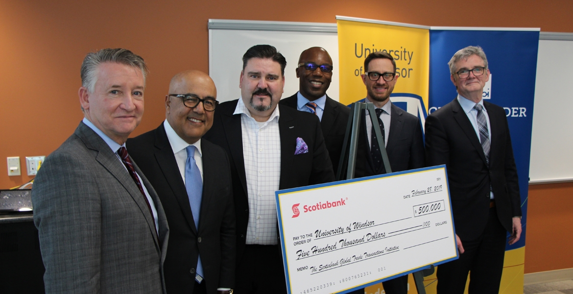 UWindsor interim president Douglas Kneale and Cross-Border Institute director Bill Anderson flank Scotiabank officials Alex Besharat, senior vice-president and head of Canadian wealth management; Terry Roman, director and market lead of commercial banking; Charles Achampong, director of academic partnership engagement and sponsorship philanthropy; and Sean White, ScotiaMcLeod branch manager, director and wealth advisor.