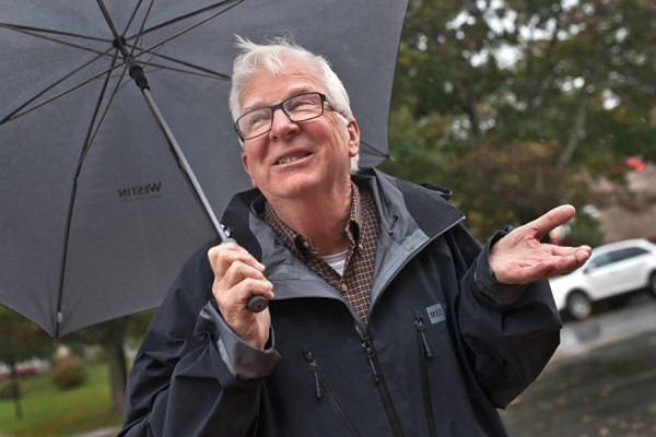 Climatologist David Phillips holding umbrella