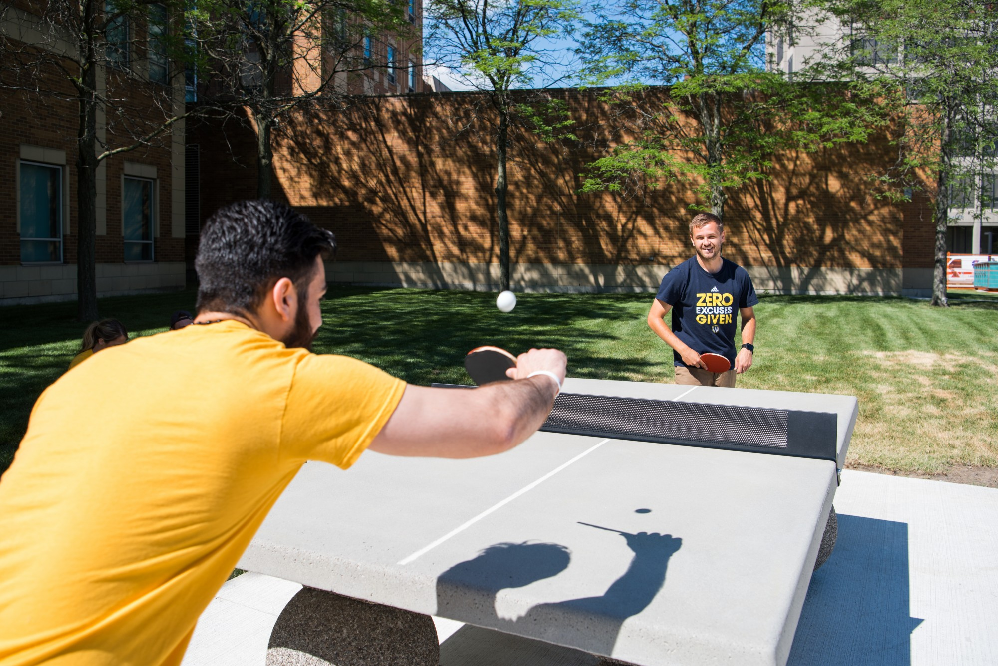 Students playing ping-pong at the David A. Wilson Commons