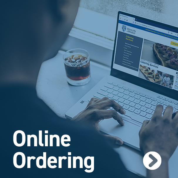 Over the shoulder angle of a user on laptop setting up a catering order