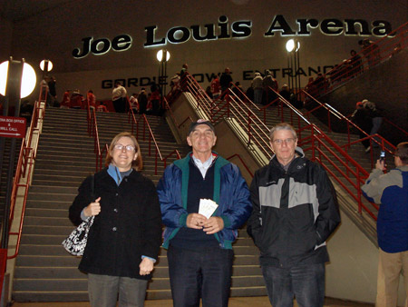 Alan Wright along with Gordon and Julie Joughin pose outside the Joe Louis Arena.