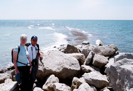 Alison Holmes and Alan Wright by rocky shore