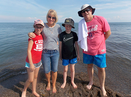 The Paterson family standing at the most southern tip of Canada.
