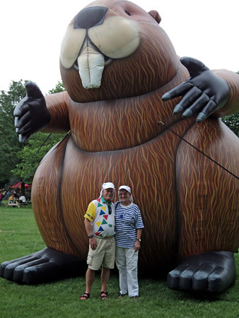 Patsy and Alan Paxton stand in front of a 25 foot high inflatable beaver.