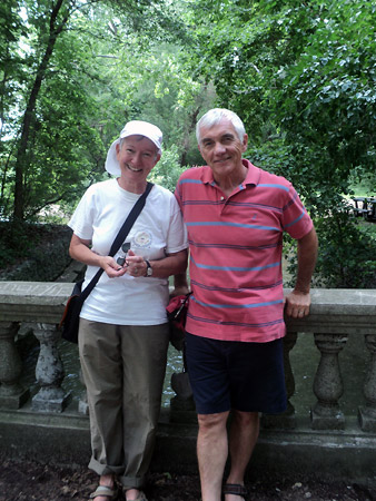 Patsy Paxton and Alan Wright pose on a bridge in front of ornate stone rails.