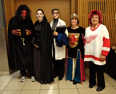 Sue Purnell dressed up for Halloween as a Detroit wing hockey fan with other members of the CTL.