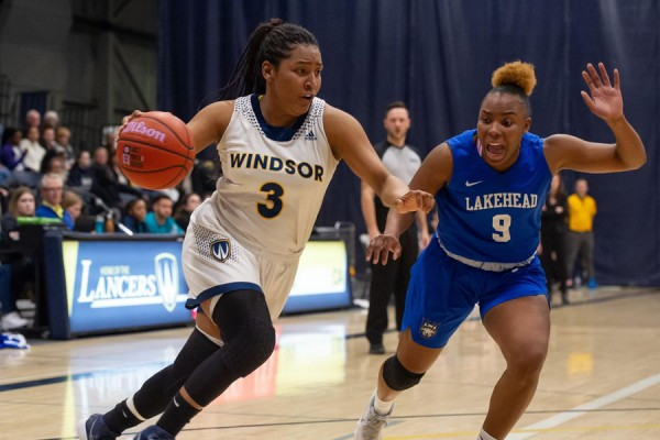 Lancer guard Kayah Clarke evades Lakehead's Tiffany Reynolds.