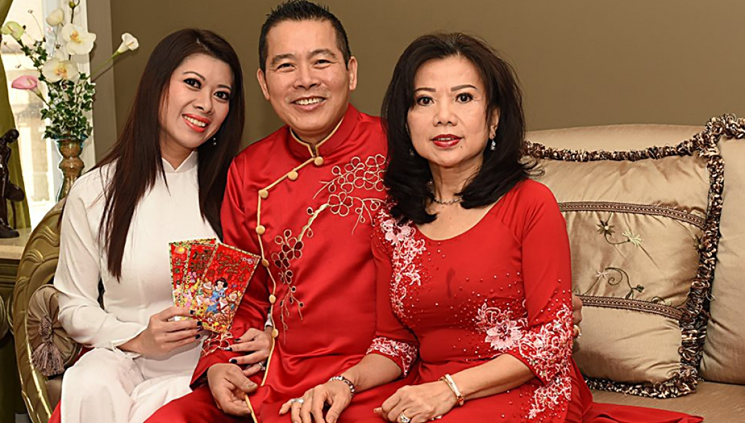 Diane Luu-Hoang with her parents in traditional dress
