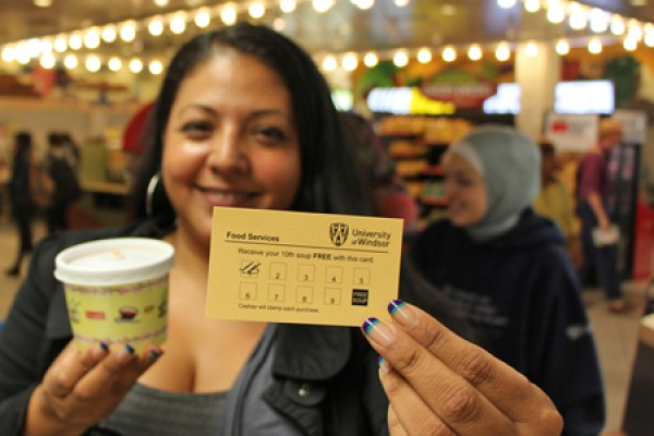 Victoria Rubio holds her frequent soup buyer card