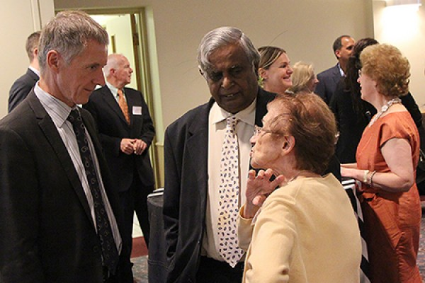 UWindsor president Alan Wildeman converses with WURA president Datta Pillay and retired drama professor Bathsheba Garnett.
