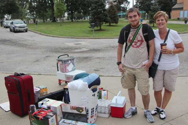 Brendan Burger and his mother Michele with piles of luggage