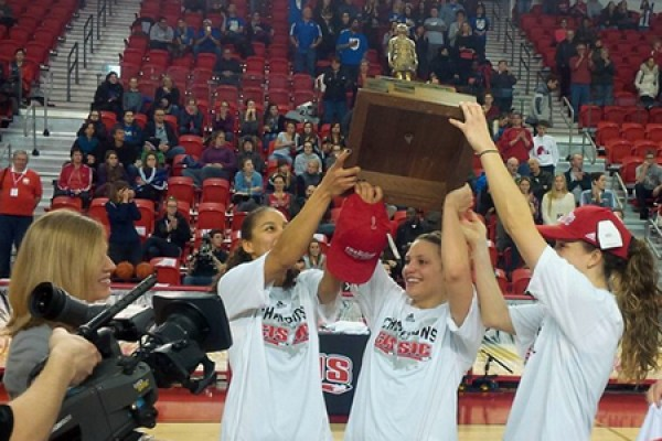 members of the Lancer women's basketball team hoist the Bronze Baby trophy