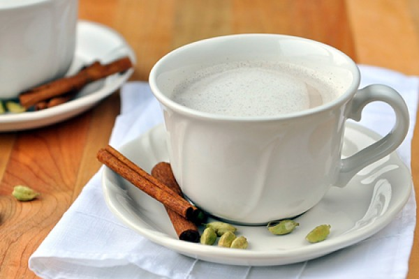 Chai tea with cardamom pods and cinamon stick