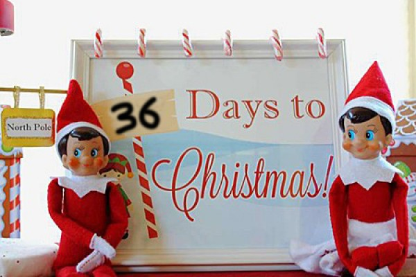 "elves under sign ""36 days til Christmas"""