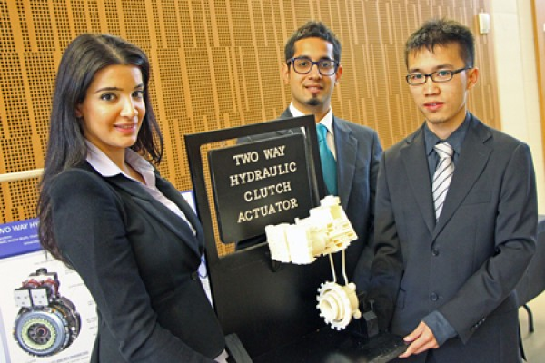 Suzan Matti, Shikhar Bhalla and Chau Yi Miao display a model of their clutch actuator design.