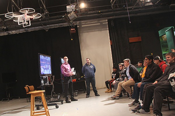 Jon Sinasac of the Centre for Teaching and Learning demonstrates a drone-mounted camera before an audience of high school students.