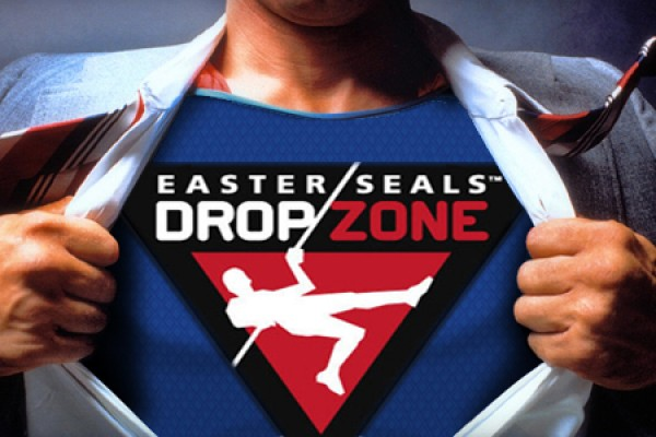 Shirt pulled open to reveal Drop Zone logo