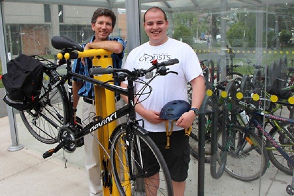 Paul Henshaw and Josh Psavka in front of Fixit station