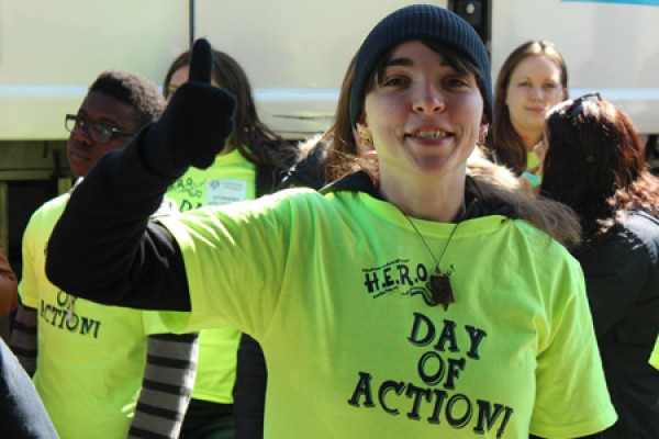 "student wearing ""Day of Action"" T-shirt"