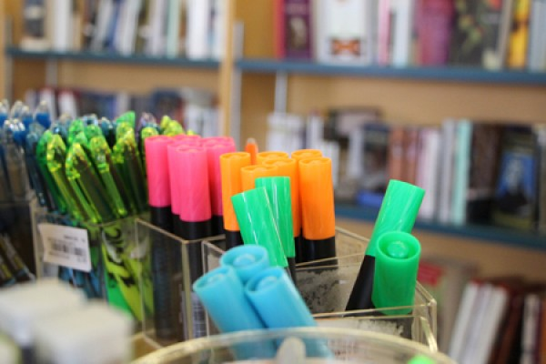 Highlighters in front of bookshelves