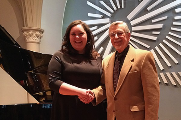 Angelica Sciacca accepts congratulations from acting performance chair Richard Householder