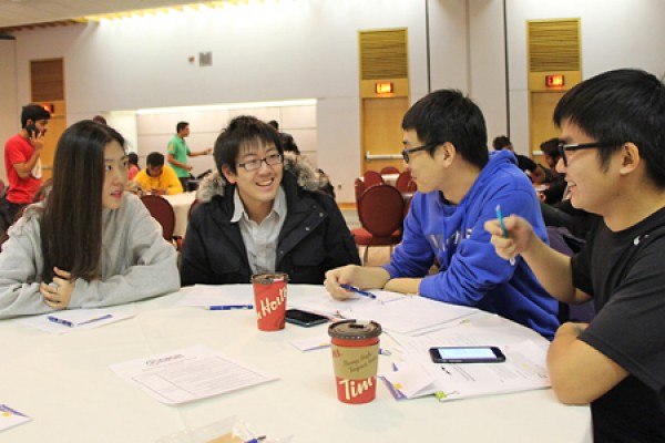 Students share a smile during the student development workshop hosted by the International Student Society.