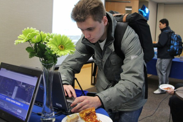 Business student Jamie Elwood registers on the EPICentre website during a launch of the platform Wednesday.