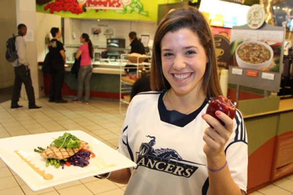 Nursing student Kelly Riccardi enjoys a healthy meal at the Marketplace.