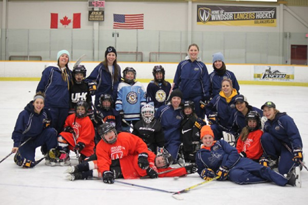 Members of the Lancer women's hockey team pose with Kent Fillies.