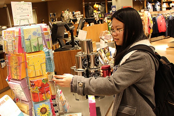 Lin Fan Li looks over a display of greeting cards
