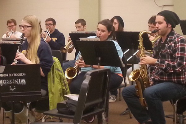 Members of the Lancer pep band practice one of their pop songs in the Music Building.