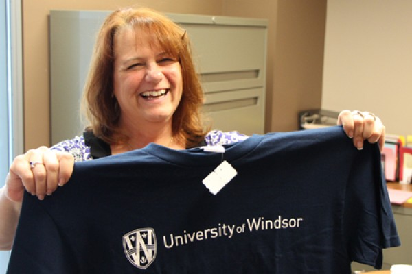 Carol Perkes shows off the T-shirt she won.