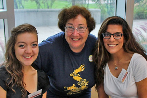 Carol Reader (centre) poses with students at a philanthropic event in September.