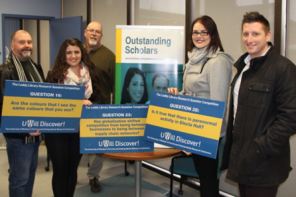 Organizers congratulate the winners of the Leddy Library Research Question Competition