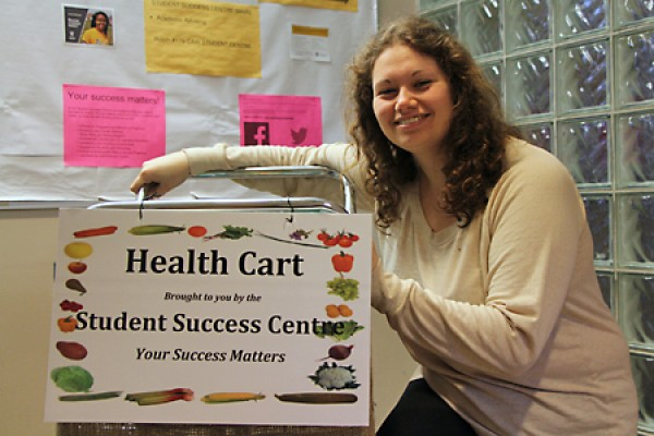 Marissa Younan poses with the health cart