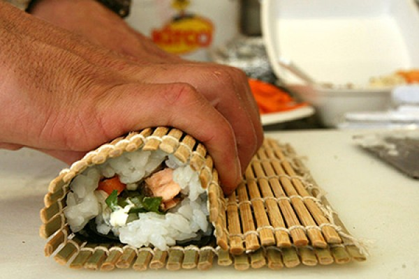 hand rolling sushi