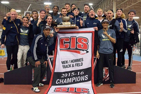 Lancer men's track and field team holding CIS banner