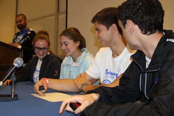 Science Olympians from Assumption College High School wrestle with a question during a fast-paced quiz game in the Toldo Health Education Centre.