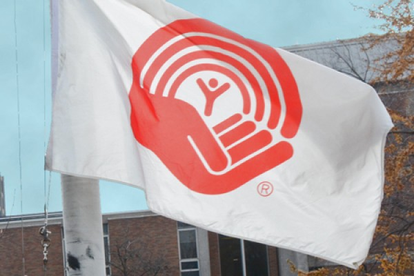 UWindsor president Alan Wildeman will raise the United Way flag over campus, Tuesday at noon outside Chrysler Hall Tower.