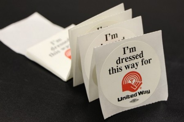 stickers reading: I'm dressed this way for United Way