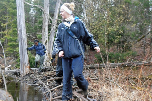 Geoscience students Marija Lelas and Leima Moro cross a beaver dam during their third-year course in field mapping.