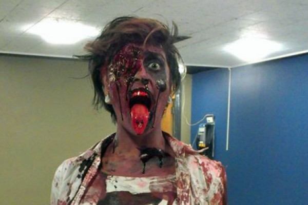 Residence assistant Komal Kundhal practices her zombie act