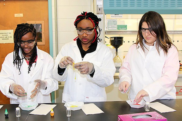 Young women create coloured slime